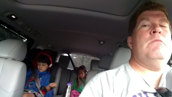 Selfie in the car with the kids engrossed in their tablets.