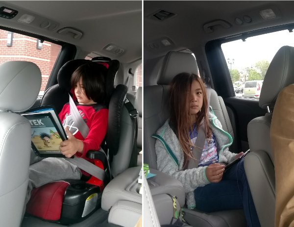 SteelyKid (r) and The Pip in the car, reading.