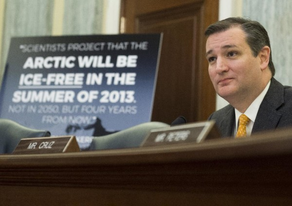 Ted Cruz, with a loaded statement from a questionable science news source, during a hearing on climate change on December 8, 2015. Image credit: SAUL LOEB/AFP/Getty Images.
