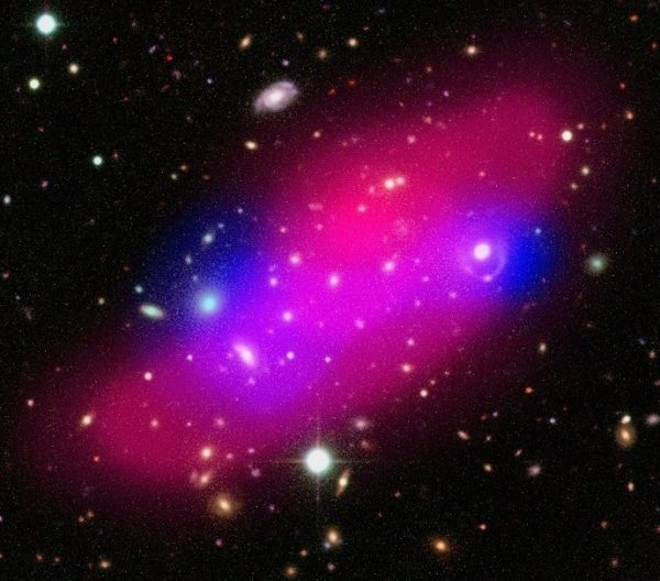 Composite image of the Bullet Group showing galaxies, hot gas (shown in pink) and dark matter (indicated in blue). Image credit: ESA / XMM-Newton / F. Gastaldello (INAF/IASF, Milano, Italy) / CFHTLS