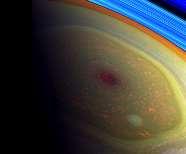 A false-color image highlighting Saturn's hurricane over its north pole, inside the much larger hexagon-shaped feature. Image credit: NASA/JPL-Caltech/SSI.