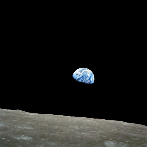 The first view with human eyes of the Earth rising over the limb of the Moon. Note how bright the Earth appears in comparison to the Moon. Image credit: NASA / Apollo 8.
